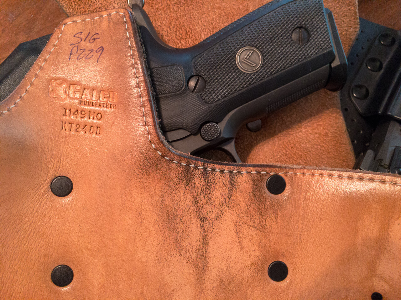 This Galco KingTuk holster comes standard with a combat cut. In addition to making the draw easier, it leaves the magazine release unhindered.