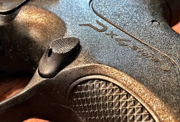 An aggressive magazine release button paired with certain holsters can cause problems.