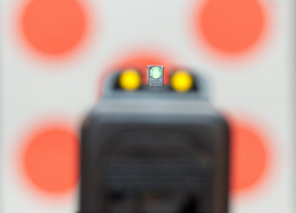 Rather than trying to time the shot when that front sight is dead center, focus on a smooth trigger press.