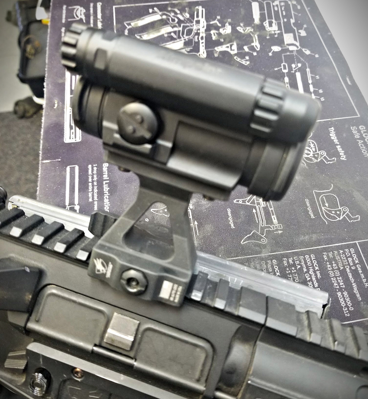The Aimpoint CompM5 mounted to the ADM Mod 1 UIC rifle.