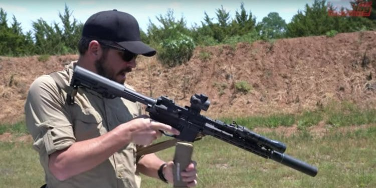 Daniel Shaw demonstrates a proper way to load an AR-15.